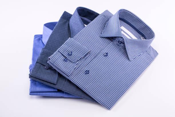メンズ t シャツのセット。白い背景上に畳んだ。 - 襟付きシャツ ストックフォトと画像