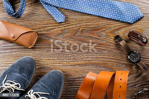 917262406istockphoto Men's shoes and accessories flat lay on a wooden background. 888113328