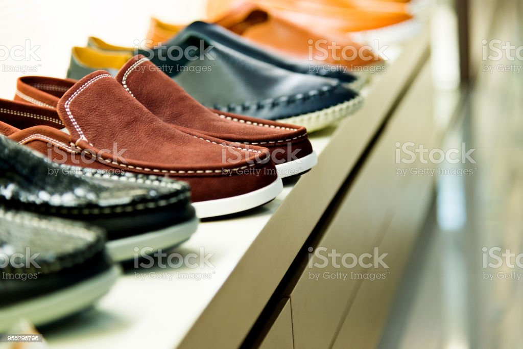 Men's shoes on sale displayed in a store stock photo