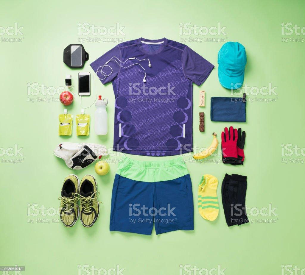 Men's training wear knolling style on green background. - foto stock