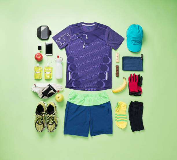 Men's training wear knolling style on green background. stock photo