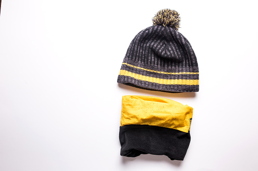 Men's winter hat and bandana for winter sports on a white background