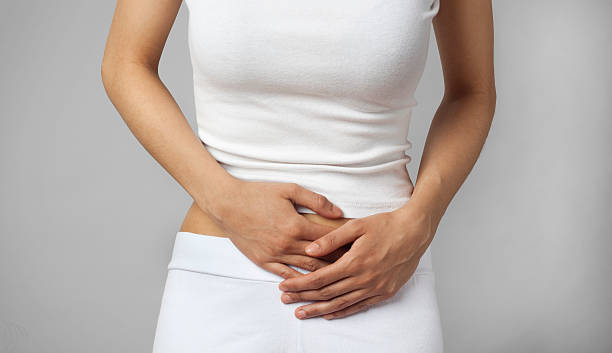 Menstrual Cramps or stomachache stock photo