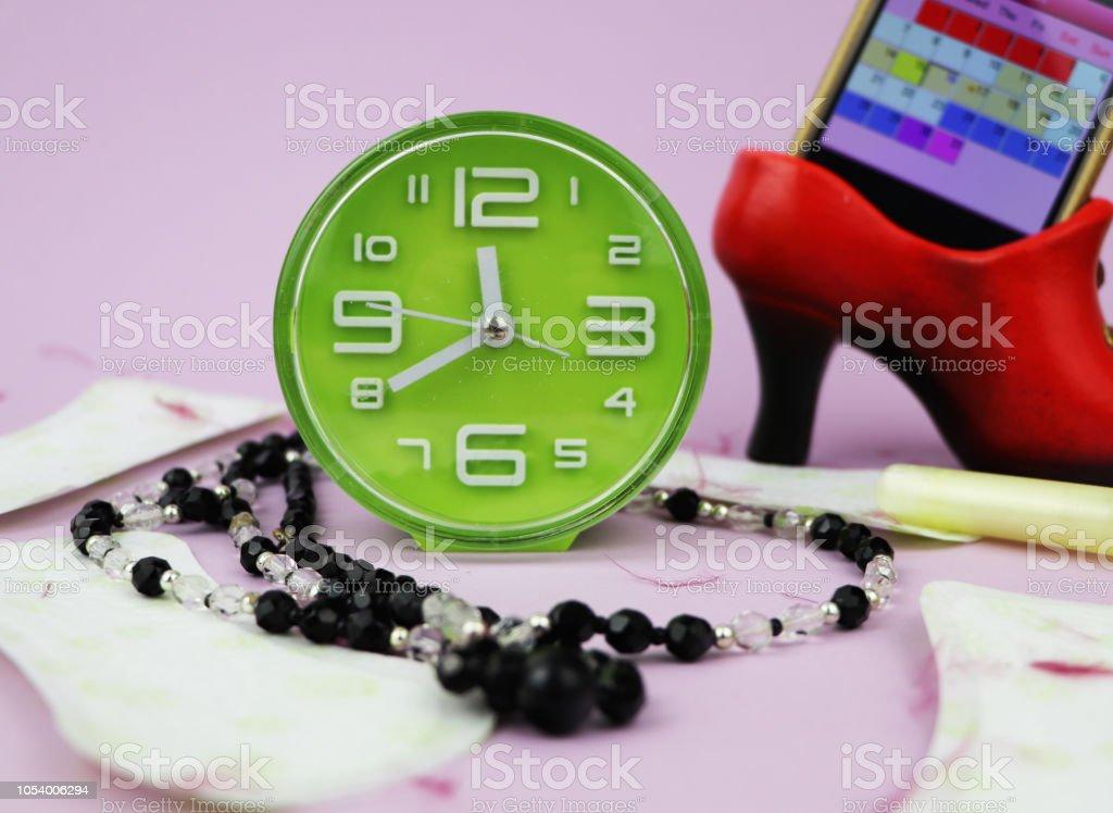 Menstrual pads, blood period calendar and clocks. Menstruation period...