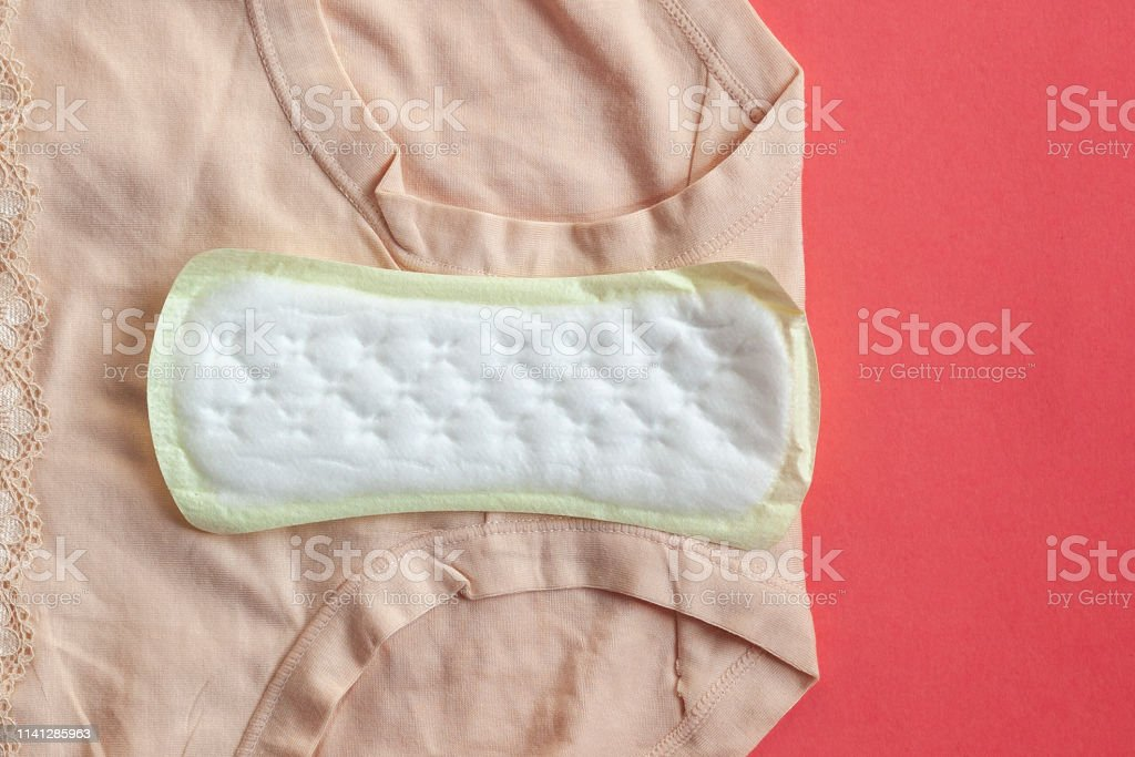 Menstruation sanitary pads for woman hygiene protection on plaid at...