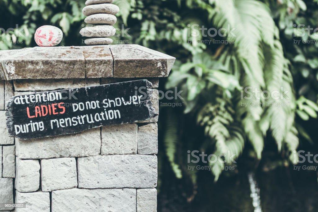Menstruation sign in the jungle of Bali island. Ladies do not shower during menstruation - Zbiór zdjęć royalty-free (Bawełna)
