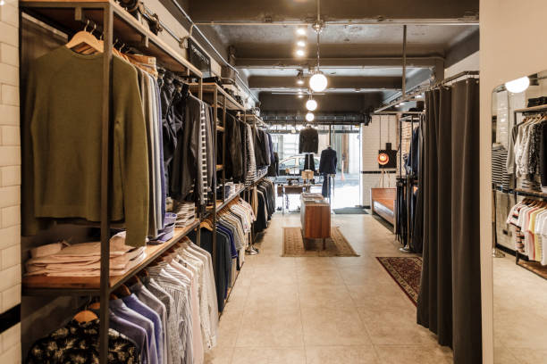 Menswear Store Interior Image of a empty tailor shop for custom clothing. mens fashion stock pictures, royalty-free photos & images