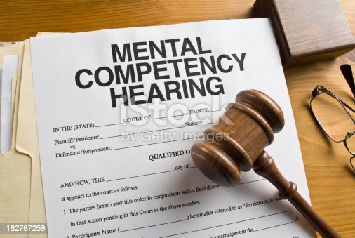 Mental Competency paperwork in a courtroom setting.