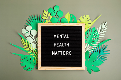 Mental health matters motivational quote on the letter board. Inspiration psycological text with paper cut leaves. Flat lay, top view