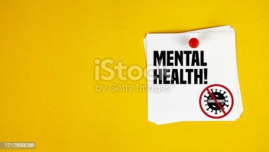 istock Mental Health motivation letter written on post-it paper against Coronavirus 1212899288