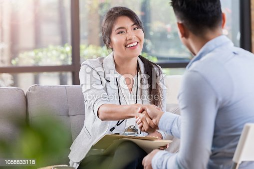 istock Mental health professional and patient warmly shake hands before meeting 1058833118