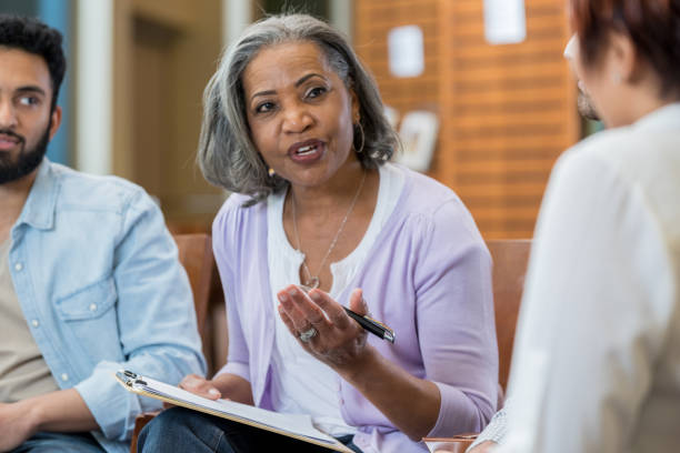 mental health professional leads support group - school counselor stock photos and pictures