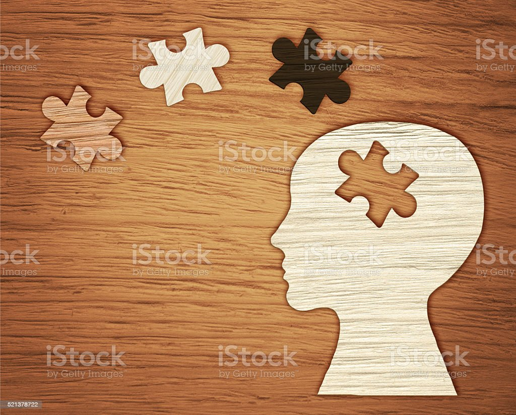 Mental health symbol. Human head silhouette with a puzzle stock photo