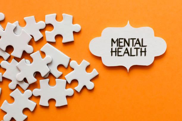 Mental Health Text On Orange Background stock photo