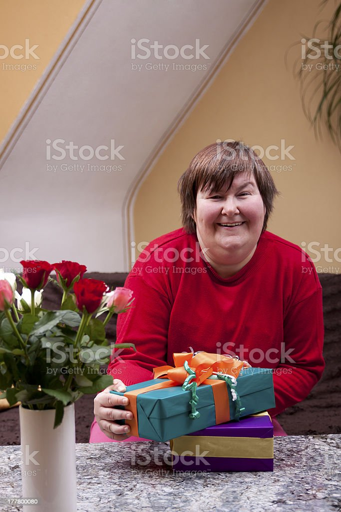 Mentally disabled woman holding many gifts Mentally defective woman holding many gifts Adult Stock Photo
