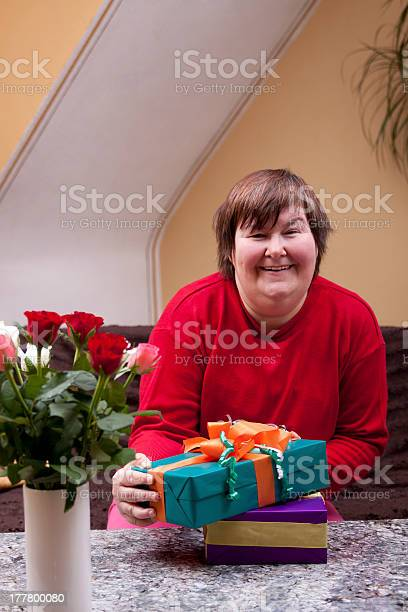 Mentally Disabled Woman Holding Many Gifts Stock Photo - Download Image Now