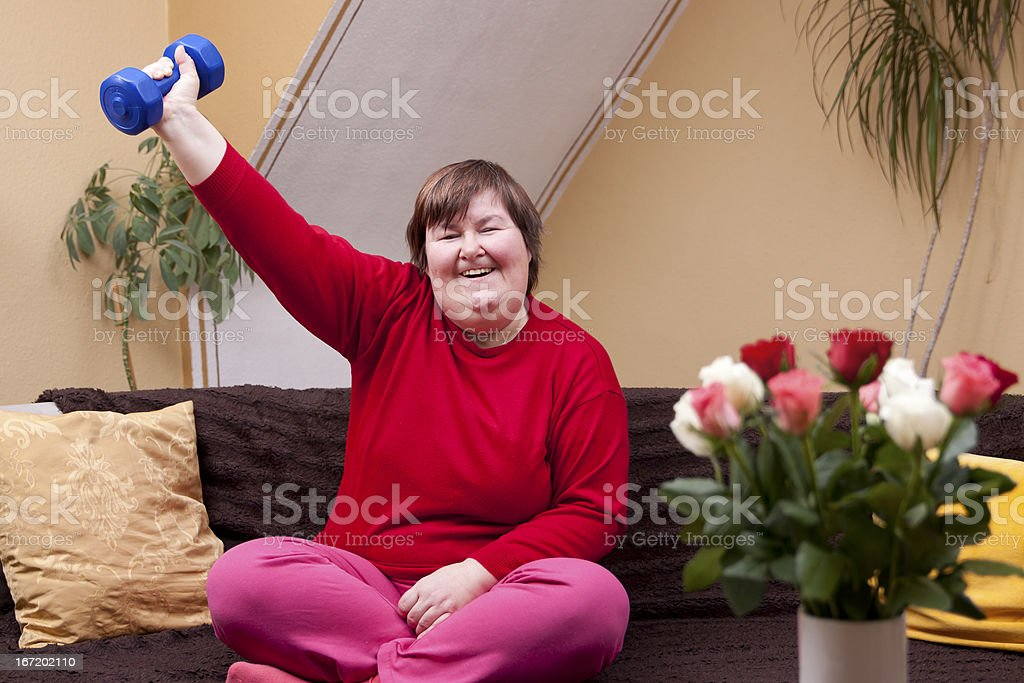 Mentally disabled woman shows her strength royalty-free stock photo