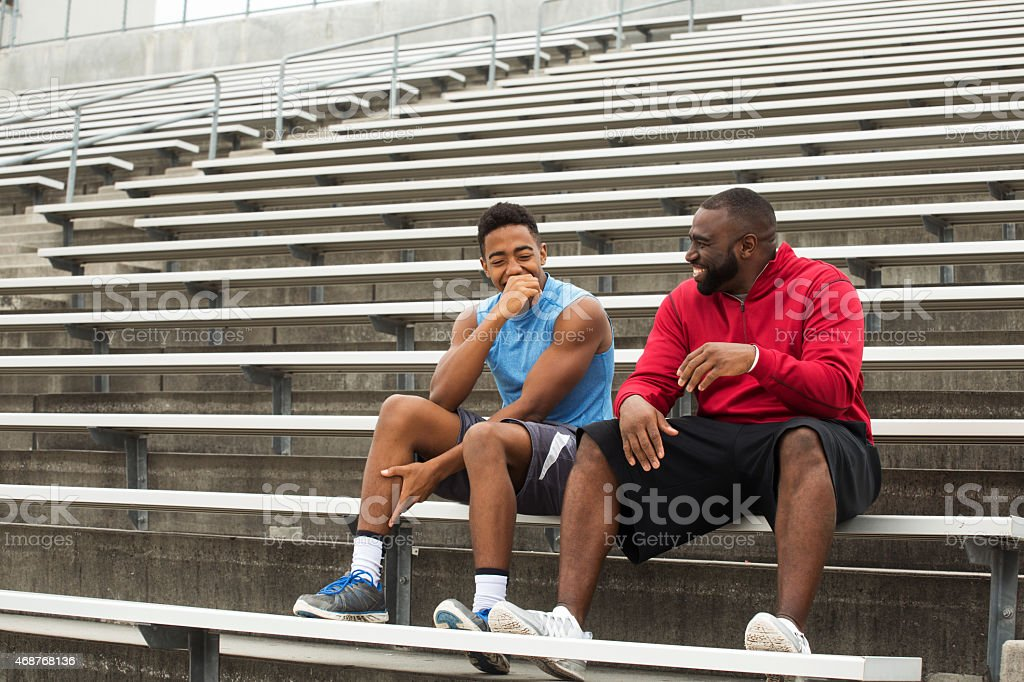 Mentor and role model spending time with the youth. stock photo