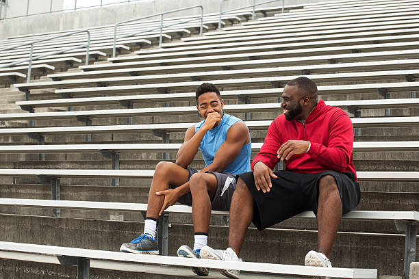 mentor and role model spending time with the youth. - high school sports stock pictures, royalty-free photos & images