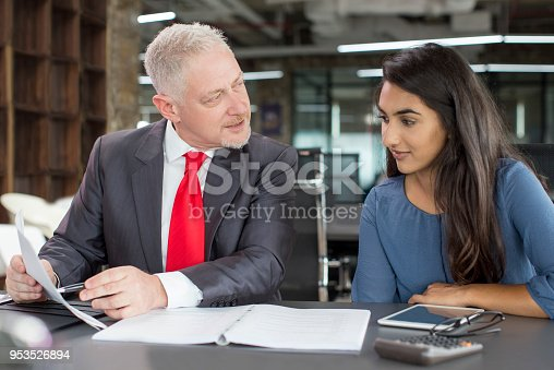 istock Mentor coaching young female professional 953526894