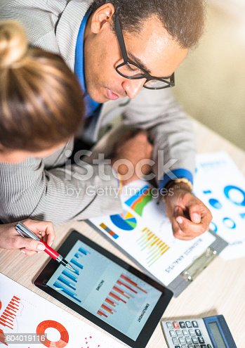 istock Mentorship and teamwork in office 604019116