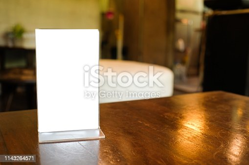 istock Menu frame space for text marketing promotion standing on wood table in Bar restaurant cafeใ 1143264571