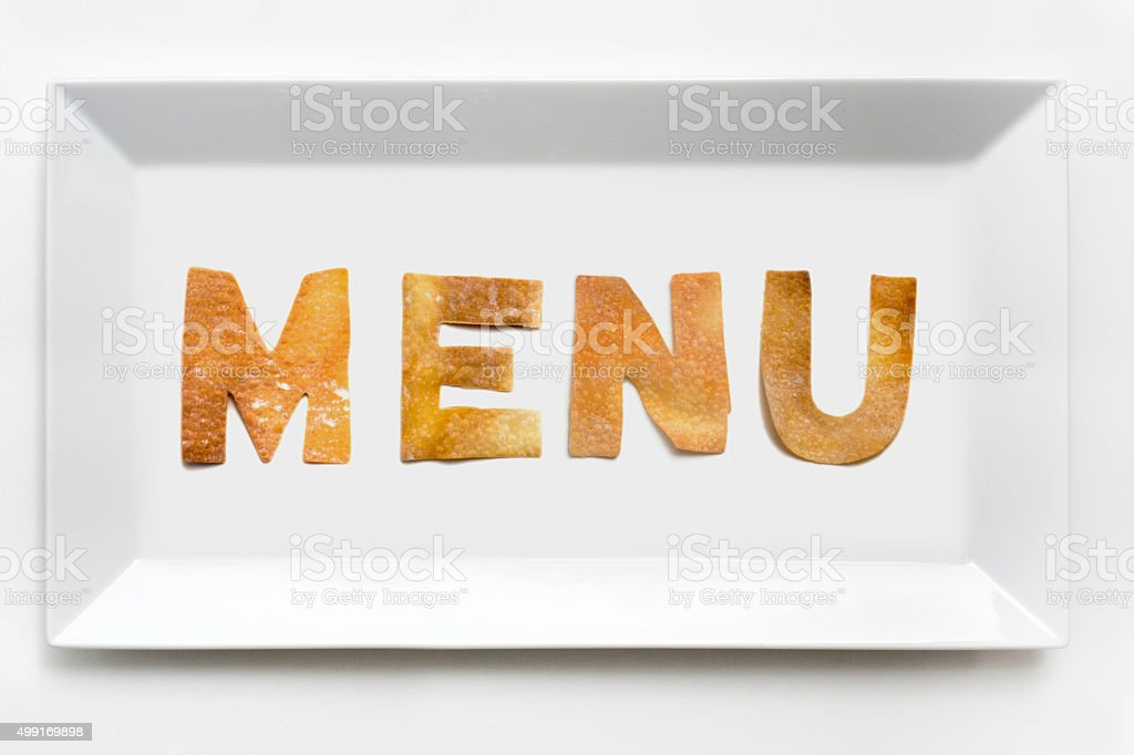 Menu in pastry letters on white porcelain rectangular plate stock photo