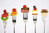 Foods on forks.