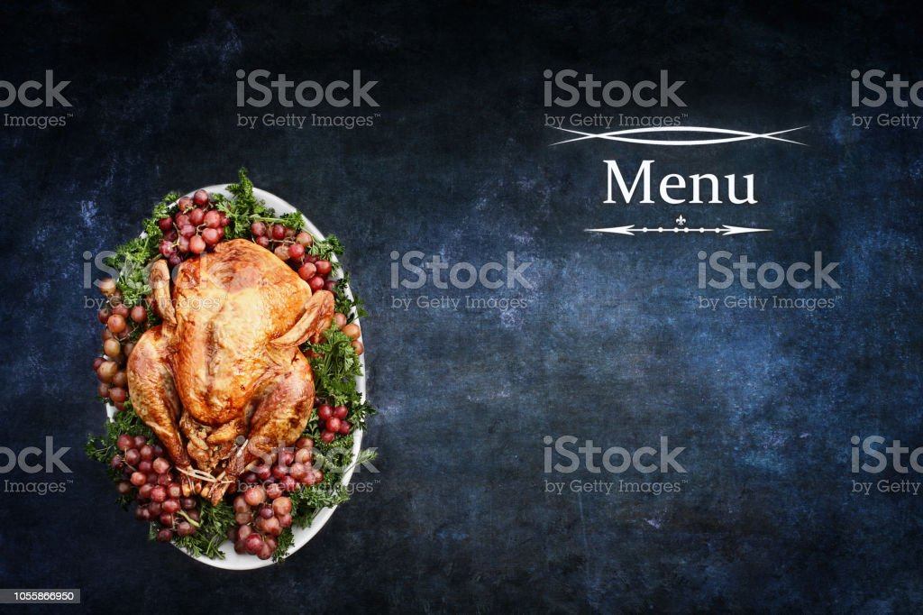 Menu with Roast Turkey over Chalkboard Texture Background stock photo