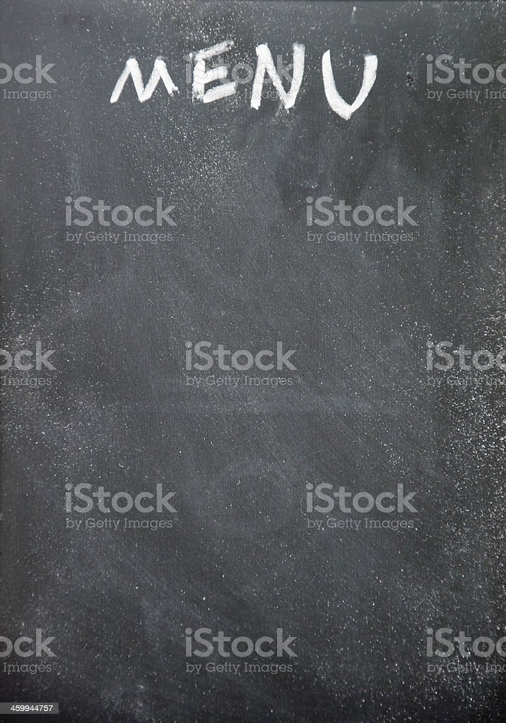 Menu written in chalk on a black board with room for text stock photo