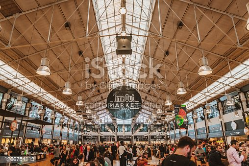 November 9th, 2019 – Lisbon, Portugal: Mercado da Ribeira Hosting the Time Out Market at Cais do Sodré. The Lisbon market has around 36 restaurants and kiosks selling regional specialties, such as Azeitão sheep's cheese, Alentejo ham, custard tarts from Manteigaria, shellfish and grilled fish, wines and chocolates.