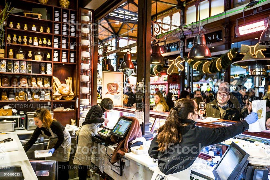 Mercado San Miguel, Madrid: vendors serving customers stock photo