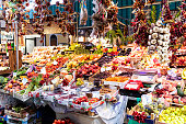 Florence, Italy - August 30, 2018: Mercato centrale, central market with stall selling fresh farmers produce fruit vegetables
