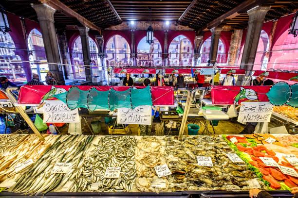 mercato di rialto - venice, italy Venice, Italy - March 12: famous Mercato di Rialto - fish- and farmers-market near the rialto bride in venice on March 12, 2019 mercato stock pictures, royalty-free photos & images
