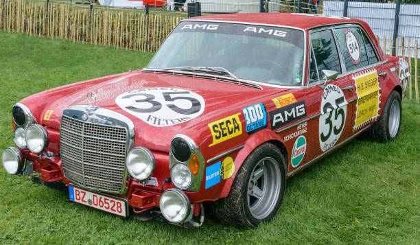 AMG Mercedes Benz 300SEL classic racecar AMG Mercedes Benz 300SEL based on the Mercedes-Benz 300 SEL 6.3, a luxury car built by Mercedes Benz from 1968 to 1972. People in the background are looking at the cars. spa belgium stock pictures, royalty-free photos & images