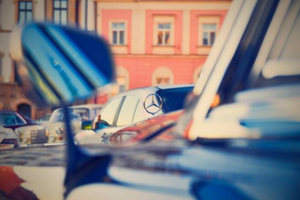 Mercedes Benz logo on vintage car. Mercedes-Benz is a German automobile manufacturer. The brand is used for luxury automobiles, buses, coaches and trucks. Retro filter added. stock photo
