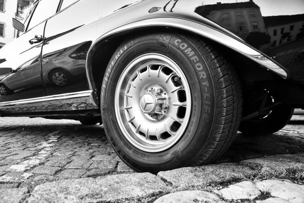 Mercedes Benz logo on vintage car wheel. Semperit logo on tyre. Mercedes-Benz is a German automobile manufacturer. The brand is used for luxury automobiles, buses, coaches and trucks. Black white image. stock photo