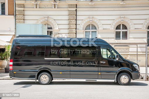 Mercedes Benz sprinter black luxury shuttle bus van parked on the street. June - 12. 2018. Novi Sad, Serbia.