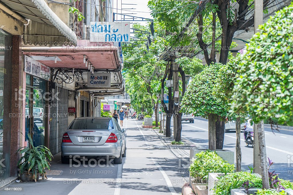Mercedes is parking illegally on Sukhumvit Foot Path stock photo