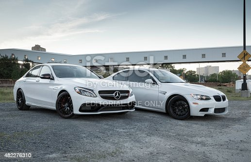 Halifax, Nova Scotia, Canada - June 27, 2015: A Mercedes-AMG C63 S and a BMW M3 in an abandoned agricultural area.  The Mercedes-AMG C63 S features a new 4.0-liter twin-turbo V-8 with 503hp.  This E92 BMW M3 is the fourth generation of the M3 and contains 414hp.