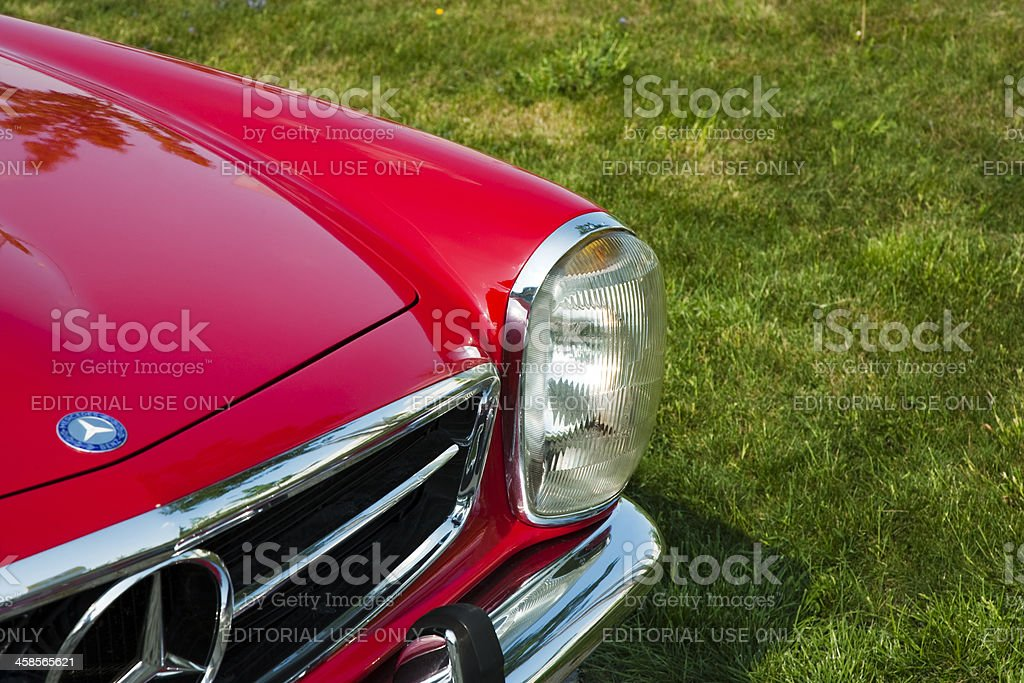 Mercedes-Benz 280SL Pagoda, Front Detail Against Green Grass royalty-free stock photo