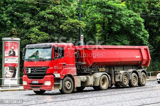 Prague, Czech Republic - July 21, 2014: Red dump truck Mercedes-Benz Axor 1843 in the city street.