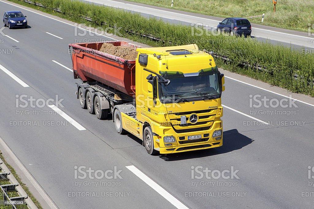 Mercedes-Benz dump truck on German highway stock photo