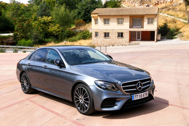 Mercedes-Benz E220d Torija, Spain - September 9, 2019: Grey luxury car Mercedes-Benz E220d (W213) in the city street. letter e stock pictures, royalty-free photos & images