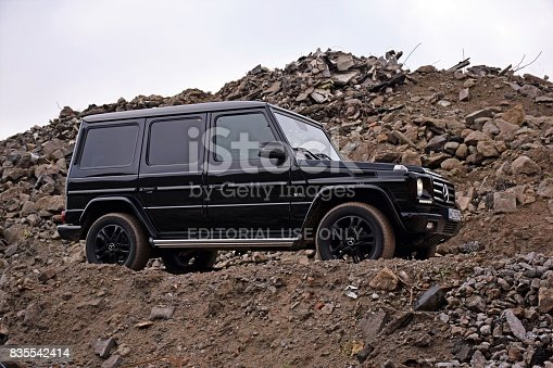 Kampinos, Poland - December 2nd, 2015: Mercedes-Benz G500 stopped on the road with rubble. The G-Class model is the oldest car in the Mercedes-Benz offer (debut in 1978).