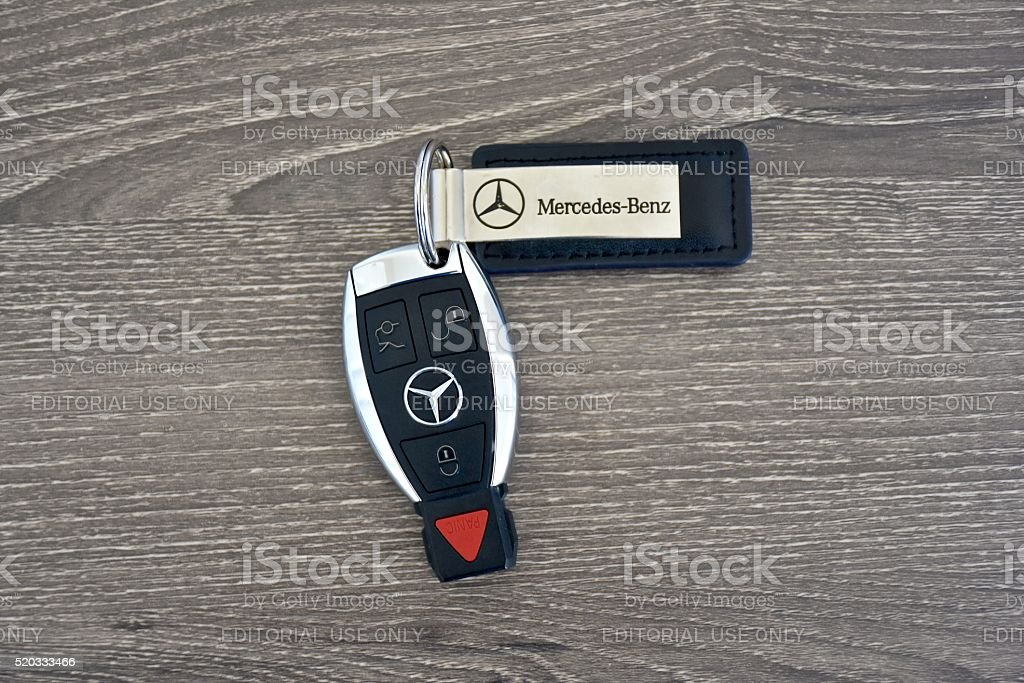 Mercedes-Benz key fob on wood surface stock photo