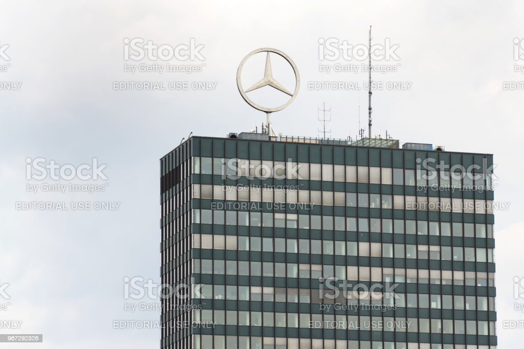 Mercedes-Benz logo on top of headquarters building in Berlin, Germany – zdjęcie