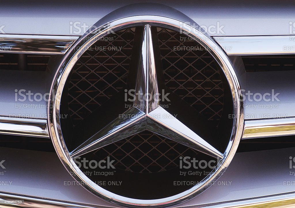"""Mercedes-Benz logo """"Bassano del Grappa, Italy - February 17, 2012: Close-up of the three-pointed star logo and chrome grille detail from a C-Class Mercedes-Benz."""" Black Color Stock Photo"""