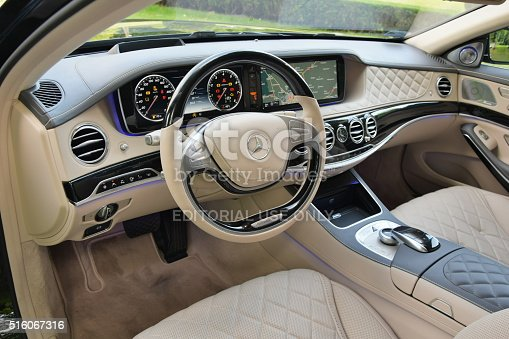 Warsaw, Poland - June, 3rd, 2015: Interior in extremely luxurious limousine Mercedes-Benz Maybach S600. This limousine is one of the most luxury and comfortable vehicles in the world. This elegant interior is made with luxury materials, for example precious wood, aluminium and cowhide.