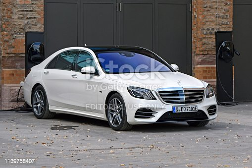 Stuttgart, Germany - 11 October, 2018: Mercedes-Benz S-Class EQ Plug-in Hybrid on the temporary public charging station. This model is the most luxury limousine in Mercedes-Benz offer.